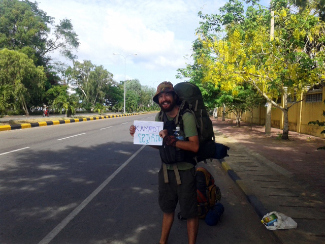 Hitch-hiking in Cambodia. What a nice weather!